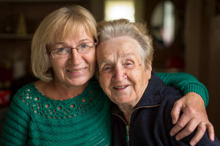 Portrait of an adult woman with his elderly mother. Stock Photo