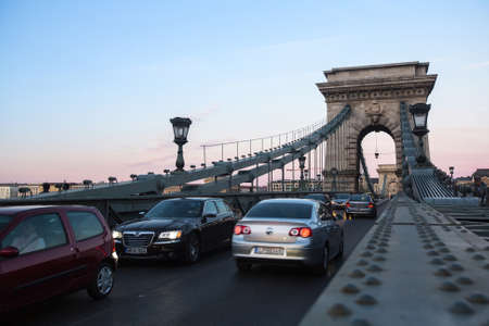 incentives: BUDAPEST, HUNGARY - SEPT 20, 2015: Traffic on the Chain Bridge in Budapest. Opened on 20 Nov 1849, Bridge became one of incentives of unification of Buda and pest into one city Budapest.