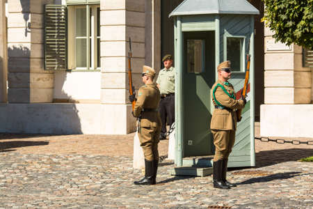 castle district: BUDAPEST, HUNGARY - SEPT 21, 2015: Changing of the Guards by the Hungarian Presidential Palace in the Buda Castle District in Budapest. (National Home Defense Ceremonial Band)