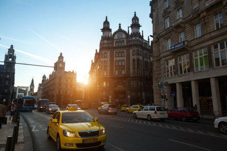 establishing: BUDAPEST, HUNGARY - SEPT 20, 2015: Traffic on the street in the historic centre of Budapest.