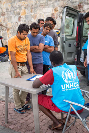 middle east war: KOS, GREECE - SEP 27, 2015: War refugees are registered employees of the UNHCR - The UN Refugee Agency. Kos island is located just 4 kilometers from the Turkish coast, and refugees come from Turkey on inflatable boats.