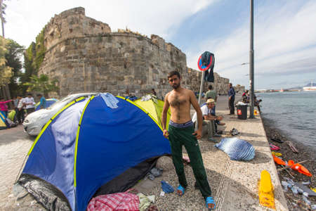war refugee: KOS, GREECE - SEP 27, 2015: Unidentified war refugee near the tents. Kos island is located just 4 kilometers from the Turkish coast, and many refugees come from Turkey in an inflatable boats.