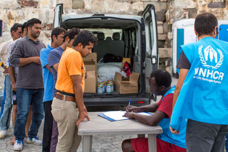 war refugee: KOS, GREECE - SEP 27, 2015: War refugees are registered employees of the UNHCR - The UN Refugee Agency. Kos island is located just 4 kilometers from the Turkish coast, and refugees come from Turkey on inflatable boats.