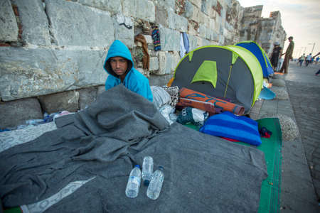syrian war: KOS, GREECE - SEP 28, 2015: Unidentified Refugee. Kos island is located just 4 kilometers from the Turkish coast, and many refugees come from Turkey in an inflatable boats. Editorial