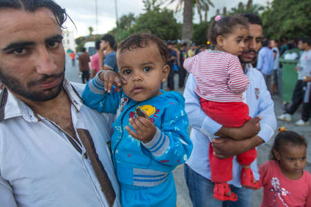 KOS, GREECE - SEP 28, 2015: Unidentified children war refugees. More than half are migrants from Syria, but there are refugees from other countries - Afghanistan, Pakistan, Iraq, Iran, Bangladesh.
