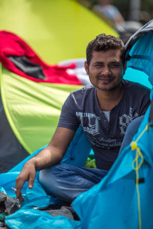 war refugee: KOS, GREECE - SEP 28, 2015: Unidentified war refugee. More than half are migrants from Syria, but there are refugees from other countries -Afghanistan, Pakistan, Iraq, Iran, Mali, Somalia.