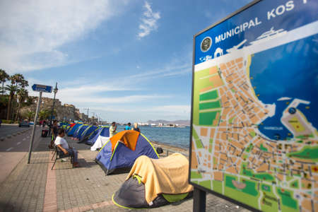 kos: KOS, GREECE - SEP 27, 2015: Tents war refugees in the port of Kos island. Kos island is located just 4 kilometers from the Turkish coast, and many refugees come from Turkey in an inflatable boats.