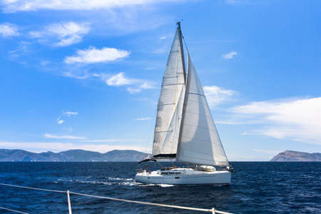 yacht race: Ship yachts with white sails in the Sea. Sailing yacht race. Luxury boats.