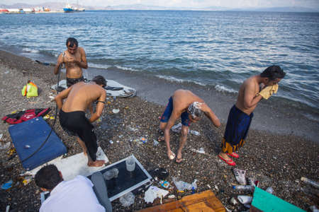 come up to: KOS, GREECE - SEP 28, 2015: Unidentified war refugees wash up on the beach. Kos island is located just 4 kilometers from the Turkish coast, and many refugees come from Turkey in an inflatable boats.