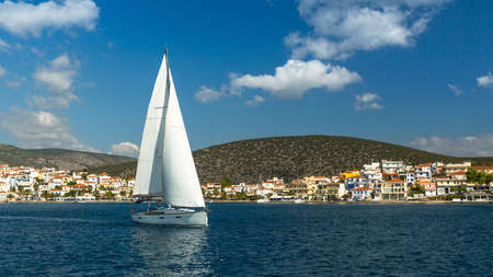 yacht race: Sailing near Greek Islands. Yachting. Luxury Yachts.