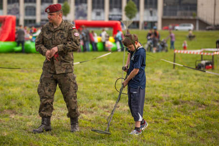 public demonstration: KRAKOW, POLAND - MAY 3, 2015: Unidentified child during demonstration of the military and rescue equipment during annual Polish national and public holiday the Constitution Day May 3rd.