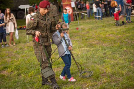 public holiday: KRAKOW, POLAND - MAY 3, 2015: Unidentified child during demonstration of the military and rescue equipment during annual Polish national and public holiday the Constitution Day May 3rd.
