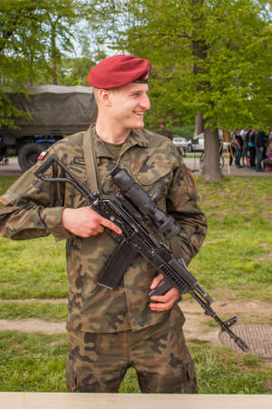public demonstration: KRAKOW, POLAND - MAY 3, 2015: Polish soldier during demonstration of the military and rescue equipment during annual Polish national and public holiday the Constitution Day May 3rd.