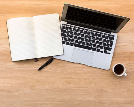 open notebook: An open notebook with a pen and notebook with coffee Cup on a light wooden table. Picture with space for your text.