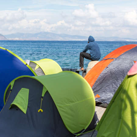 kos: KOS, GREECE - SEP 28, 2015: Tents war refugees in the port of Kos island. Kos island is located just 4 kilometers from the Turkish coast, and many refugees come from Turkey in an inflatable boats. Editorial