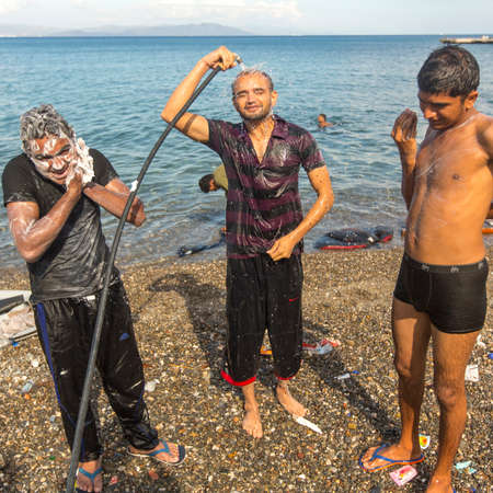 come up to: KOS, GREECE - SEP 27, 2015: Unidentified war refugees wash up on the beach. Kos island is located just 4 kilometers from the Turkish coast, and many refugees come from Turkey  in an inflatable boats. Editorial