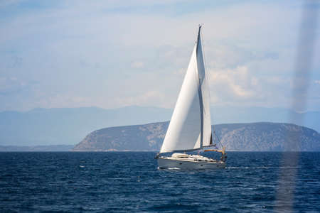 yacht race: Ship yacht with white sails in the Sea. Sailing yacht race.