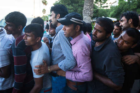 immigration: KOS, GREECE - SEP 28, 2015: Unidentified refugees. More than half are migrants from Syria, but there are refugees from other countries - Afghanistan, Pakistan, Iraq, Iran, Mali, Bangladesh, Eritrea.
