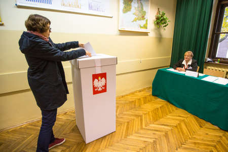 parliamentary: KRAKOW, POLAND - OCTOBER 25, 2015: Unidentified voter at the polling station during polish parliamentary elections to both the Sejm and Senate.