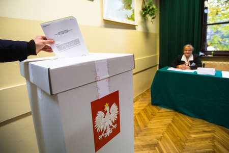senate elections: KRAKOW, POLAND - OCTOBER 25, 2015: Unidentified voter at the polling station during polish parliamentary elections to both the Sejm and Senate.