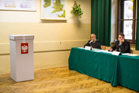 senate elections: KRAKOW, POLAND - OCTOBER 25, 2015: At the polling station during polish parliamentary elections to both the Sejm and Senate.