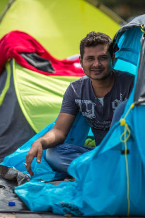 war refugee: KOS, GREECE - SEP 28, 2015: War Refugee in tents. More than half are migrants from Syria, but there are refugees from other countries -Afghanistan, Pakistan, Iraq, Iran, Mali, Eritrea.