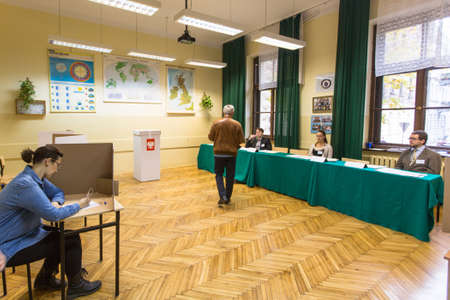 voters: KRAKOW, POLAND - OCTOBER 25, 2015: Unidentified voters at the polling station during polish parliamentary elections to both the Sejm and Senate. Editorial