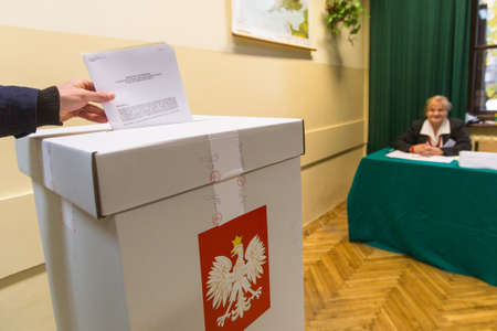 electorate: KRAKOW, POLAND - OCTOBER 25, 2015: Unidentified voter at the polling station during polish parliamentary elections to both the Sejm and Senate.