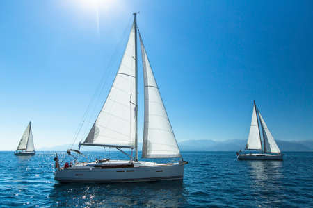 Sailing regatta. Sailing in the wind through the waves. Luxury yachts. 스톡 콘텐츠