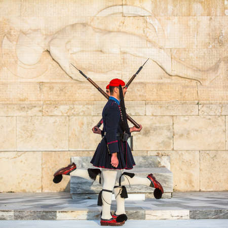 tomb unknown soldier: ATHENS, GREECE - CIRCA APR, 2015: Evzone guarding the Tomb of Unknown Soldier in Athens dressed in service uniform, refers to the members of the Presidential Guard, an elite ceremonial unit.