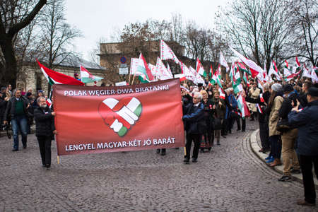 patriotism: KRAKOW, POLAND - NOV 11, 2015: Unidentified participants celebrating National Independence Day an Republic of Poland - is a public holiday, celebrated every year from 1918 year. Editorial