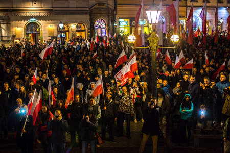 nationalists: KRAKOW, POLAND - NOV 11, 2015: Nationalists protest in center of Krakow. About 3.000 people took part in March of Free Poland. Participants chanted slogans Neither EU nor NATO, Poland only for Poles. Editorial