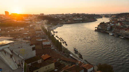 recognised: PORTO, PORTUGAL - NOV 8, 2015: View of Douro river and Ribeira during sunset. In 1996, UNESCO recognised Old Town of Porto as a World Heritage Site.