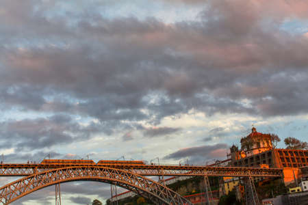proclaimed: PORTO, PORTUGAL - NOV 6, 2015: Dom Luis I Bridge at center of Old Porto. Porto is one of the oldest European cities and its historical core was proclaimed a World Heritage Site by UNESCO in 1996.