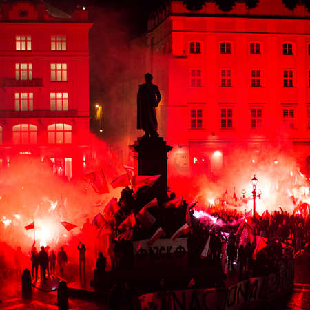 slogans: KRAKOW, POLAND - NOV 11, 2015: Nationalists protest in center of Krakow. About 3.000 people took part in March of Free Poland. Participants chanted slogans Neither EU nor NATO, Poland only for Poles. Editorial