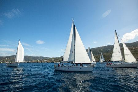 blu sky: HYDRA, GREECE - CIRCA OCT, 2014: Sailboats participate in sailing regatta Ellada Autumn 2014 among Greek island group in the Aegean Sea, in Cyclades and Argo-Saronic Gulf. Editorial