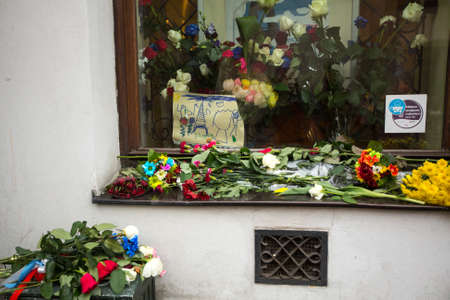 consulate: KRAKOW, POLAND - NOV 16, 2015: People put candles and flowers near the General Consulate of the French Republic to Krakow. Mourning for the victims of the terrorist attacks in Paris 13 Nov 2015. Editorial