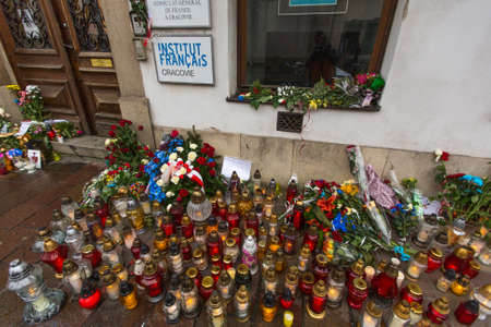 nov: KRAKOW, POLAND - NOV 16, 2015: People put candles and flowers near the General Consulate of the French Republic to Krakow. Mourning for the victims of the terrorist attacks in Paris 13 Nov 2015. Editorial