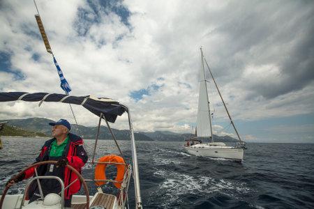 ellada: MONEMVASIA, GREECE - CIRCA MAY, 2014: Sailor participate in sailing regatta 11th Ellada 2014 Spring among Greek island group in the Aegean Sea, in Cyclades and Argo-Saronic Gulf.