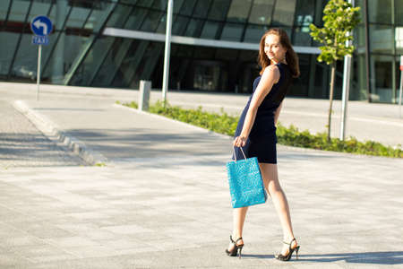 after shopping: Young fashionable girl after shopping. Stock Photo