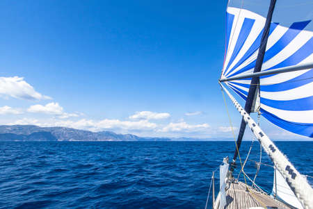 sailing ship: Sailing ship yachts with blue white sails in the Sea. Luxury boats. Stock Photo