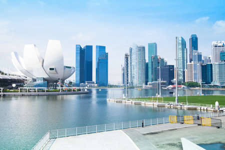 dynamically: SINGAPORE - CINCA APR, 2012: A view of city in Marina Bay business district in Singapore. Asian financial center the city state is one of the most dynamically developing countries in the world.
