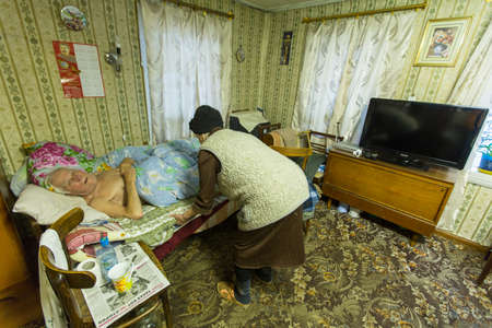 census: VINNITSY, RUSSIA - NOV 30, 2015: Elderly couple Veps - small Finno-Ugric peoples living on the territory of Leningrad region in Russia. According to the 2002 census, there were 8,240 Veps in Russia.