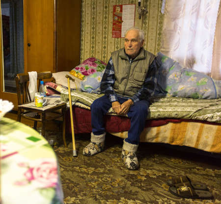 census: VINNITSY, RUSSIA - NOV 30, 2015: Elderly man Veps - small Finno-Ugric peoples living on the territory of Leningrad region in Russia. According to the 2002 census, there were 8,240 Veps in Russia.