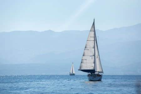 luxury lifestyle: Ship yachts with white sails in the Sea. Sailing. Luxury Lifestyle.