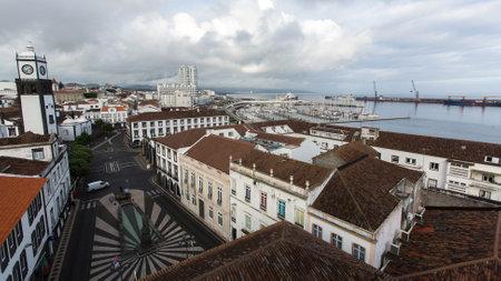 revised: PONTA DELGADA, AZORESPORTUGAL - CIRCA JUN, 2015: View of the Sea Port of Ponta Delgada. City is located on Sao Miguel Island (232.99 km2) Region capital under the revised constitution of 1976.