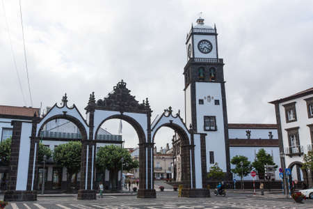 revised: PONTA DELGADA, AZORESPORTUGAL - CIRCA JUN, 2015: View of city gates in Ponta Delgada. City is located on Sao Miguel Island (233 km2) Region capital under the revised constitution of 1976. Editorial