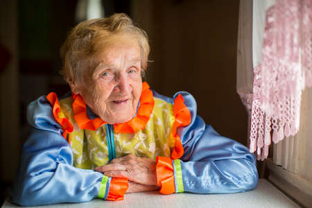 slavic: An elderly woman in bright colour Slavic ethnic costume. Stock Photo