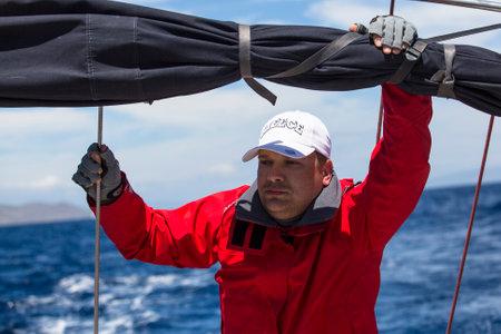 ellada: ANDROS - SYROS, GREECE - CIRCA APR, 2014: Sailors participate in sailing regatta 11th Ellada 2014 among Greek island group in the Aegean Sea, in Cyclades and Argo-Saronic Gulf. Editorial