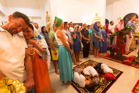 bible altar: KOH CHANG - THAILAND - JAN 7, 2016: Christmas service and the vigil on Feast of the Nativity of Christ (Russian Orthodox Church) in the temple of St. Sergius of Radonezh, built on island in Jan 2015.